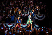 President Barack Obama and the First Lady Michelle Obama and their daughters Sasha and Malia enter the stage at the McCormick Center in Chicago after the numbers were in confirming his re-election as the President of the United States.
