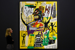"© Licensed to London News Pictures. 27/09/2019. LONDON, UK.  A staff member views ""Pyro"", 1984, by Jean-Michel Basquiat (Est. above GBP 9m).  Preview of Sotheby's Frieze Week Contemporary Art exhibition at its New Bond Street galleries.  Over 250 works by artists, including Andy Warhol, David Hockney and Jean-Michel Basquiat, will be auctioned on 3 October 2019.  Photo credit: Stephen Chung/LNP"