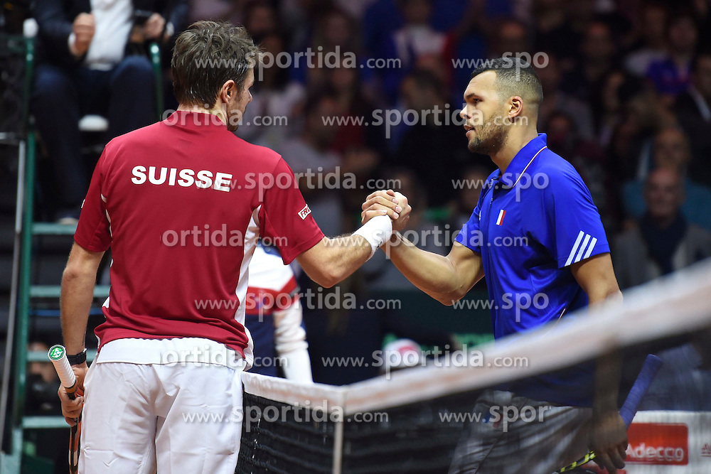 21.11.2014, Stade Pierre Mauroy, Lille, FRA, Davis Cup Finale, Frankreich vs Schweiz, im Bild Stanislas Wawrinka (SUI) und Jo Wilfried Tsonga (FRA) // during the Davis Cup Final between France and Switzerland at the Stade Pierre Mauroy in Lille, France on 2014/11/21. EXPA Pictures &copy; 2014, PhotoCredit: EXPA/ Freshfocus/ Valeriano Di Domenico<br /> <br /> *****ATTENTION - for AUT, SLO, CRO, SRB, BIH, MAZ only*****