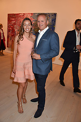 Alexandra Bailey and guest at a preview of an exhibition of art by Sassan Behnam-Bakhtiar entitled 'Oneness Wholeness' held at the Saatchi Gallery, Duke of York's HQ, King's Rd, London, England. 14 May 2018.