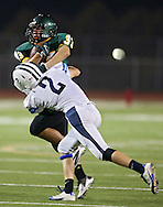 Kennedy's  Miles Moa (33) is hit by Jefferson's Anthony Shumacher (2) during first quarter of the game between Cedar Rapids Jefferson and Cedar Rapids Kennedy at Kingston Stadium in Cedar Rapids on Friday September 28, 2012. It was 24-0 Kennedy at halftime.