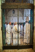 Deacons stand behind a gate near the entrance of St. Francis Xavier Cathedral in Green Bay prior to Mass May 21. (Sam Lucero photo)