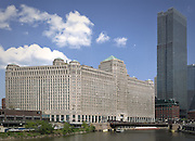 The Merchandise Mart on a relatively sunny afternoon with white fluffy clouds overhead