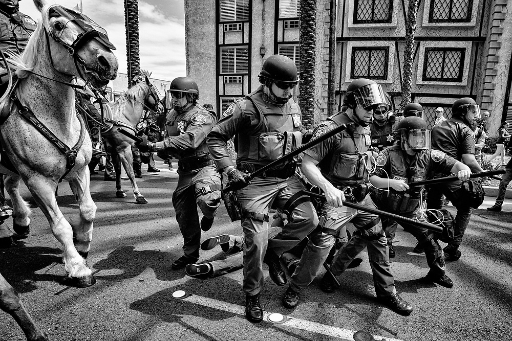 Tensions begin to boil over as clashes break out between protesters and Trump supporters. Law enforcement made several arrests before finally dispersing the crowd, hours later, far from the rally venue. Anaheim, Calif. May 26, 2016. (Photo by Gabriel Romero ©2016)