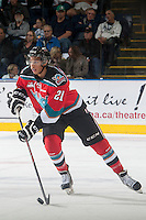 KELOWNA, CANADA - OCTOBER 7: Devante Stephens #21 of Kelowna Rockets skates with the puck against the Swift Current Broncos on October 7, 2014 at Prospera Place in Kelowna, British Columbia, Canada.  (Photo by Marissa Baecker/Getty Images)  *** Local Caption *** Devante Stephens;
