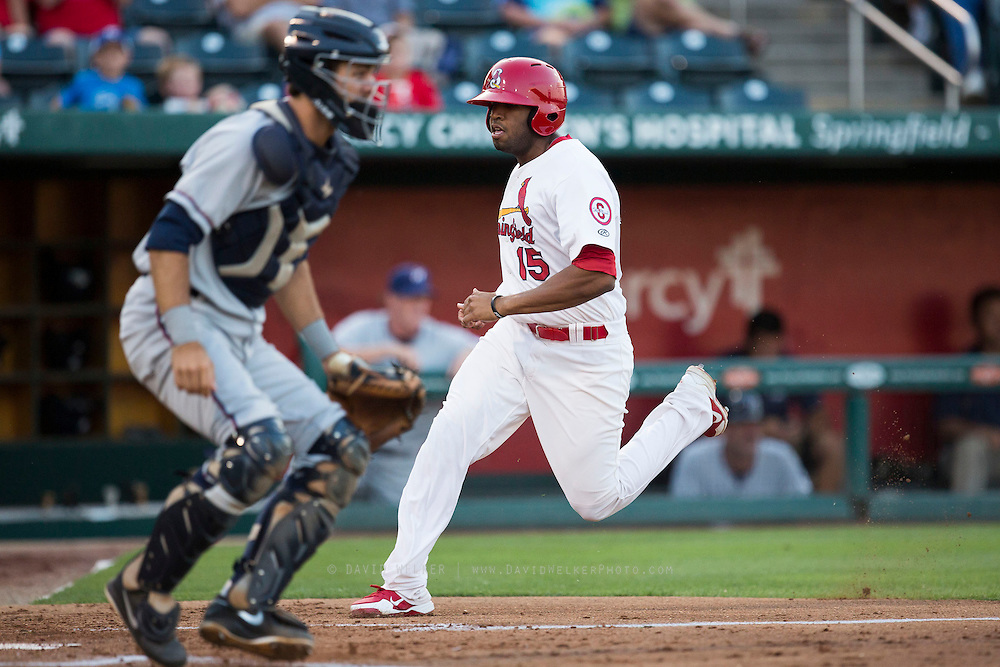 Xavier Scruggs (15) of the Springfield Cardinals crosses home plate during a game against the Northwest Arkansas Naturals at Hammons Field on August 20, 2013 in Springfield, Missouri. (David Welker)