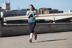 © Licensed to London News Pictures. 05/05/2018. London, UK. A woman jogging during hot and sunny weather near the River Thames in London this morning. Photo credit: Vickie Flores/LNP