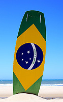 "brazilian flag painted on a kite surf board with ""praia e vento"" (beach and wind) instead of ""ordem e progresso""  in prainha beach near fortaleza"