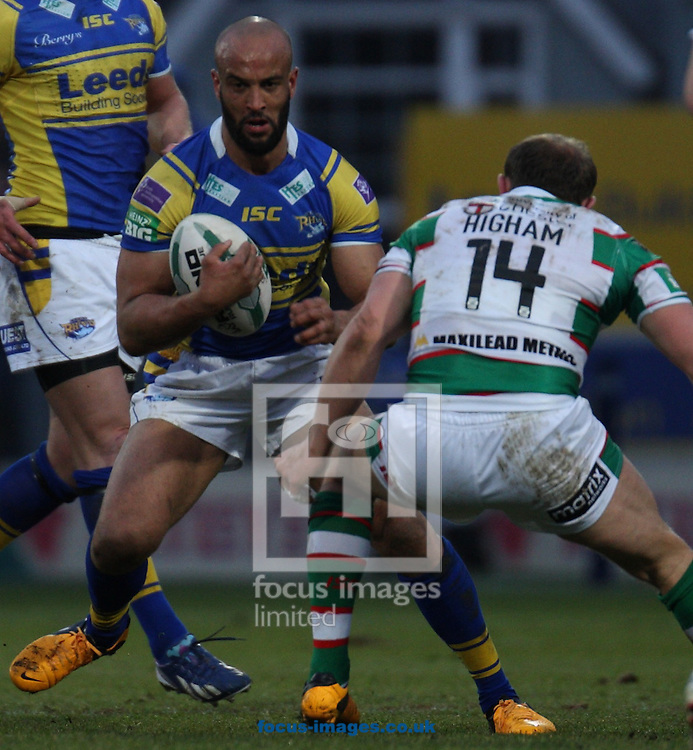 Picture by Stephen Gaunt/Focus Images Ltd +447904 833202.07/04/2013.Jamie Jones Buchanan(Left) of Leeds Rhinos tackled by Micky Higham(Right) of Warrington Wolves during the Super League match at Headingley Carnegie Stadium, Leeds.