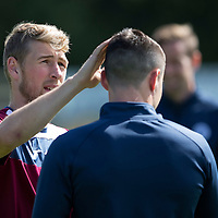 St Johnstone Training...07.08.15<br /> david Wotherspoon adjusts Michael O'Halloran's hair in training this morning<br /> Picture by Graeme Hart.<br /> Copyright Perthshire Picture Agency<br /> Tel: 01738 623350  Mobile: 07990 594431