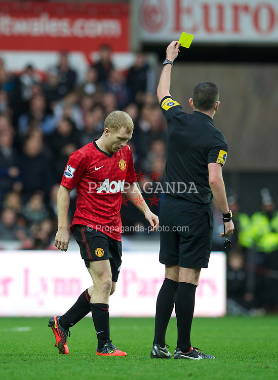 SWANSEA, WALES - Sunday, December 23, 2012: Manchester United's Paul Scholes shown the yellow card against Swansea City during the Premiership match at the Liberty Stadium. (Pic by David Rawcliffe/Propaganda)