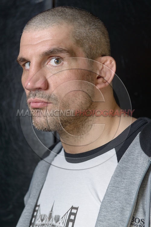 """LONDON, ENGLAND, APRIL 18, 2016: James Thompson poses for a portrait following the event announcement press conference for """"Bellator 158: Slice vs. Thompson"""" inside the Four Seasons Hotel in Park Lane, London (© Martin McNeil)"""