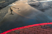 "Annapolis, Maryland - June 05, 2016: A rainbow is reflected in a puddle on Dock Street -- an example of nuisance flooding -- in Historic Annapolis, Md., Sunday June 5th, 2016. Annapolis is one of the most prone cities in the U.S. to nuisance flooding. <br /> <br /> <br /> A perigean spring tide brings nuisance flooding to Annapolis, Md. These phenomena -- colloquially know as a ""King Tides"" -- happen three to four times a year and create the highest tides for coastal areas, except when storms aren't a factor. Annapolis is extremely susceptible to nuisance flooding anyway, but the amount of nuisance flooding has skyrocketed in the last ten years. Scientists point to climate change for this uptick. <br /> <br /> <br /> CREDIT: Matt Roth for The New York Times<br /> Assignment ID: 30191272A"