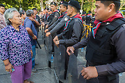 "01 FEBRUARY 2014 - BANGKOK, THAILAND: A Thai woman tries to get past police lines to go to her polling place in the Din Daeng area of Bangkok. Thais went to the polls in a ""snap election"" Sunday called in December after Prime Minister Yingluck Shinawatra dissolved the parliament in the face of large anti-government protests in Bangkok. The anti-government opposition, led by the People's Democratic Reform Committee (PDRC), called for a boycott of the election and threatened to disrupt voting. Many polling places in Bangkok were closed by protestors who blocked access to the polls or distribution of ballots. The result of the election are likely to be contested in the Thai Constitutional Court and may be invalidated because there won't be quorum in the Thai parliament.    PHOTO BY JACK KURTZ"