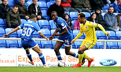 Byron Moore of Bristol Rovers takes on Ousmane Fane and Calaum Jahraldo-Martin of Oldham Athletic - Mandatory by-line: Robbie Stephenson/JMP - 22/10/2016 - FOOTBALL - Sportsdirect.com Park - Oldham, England - Oldham Athletic v Bristol Rovers - Sky Bet League One