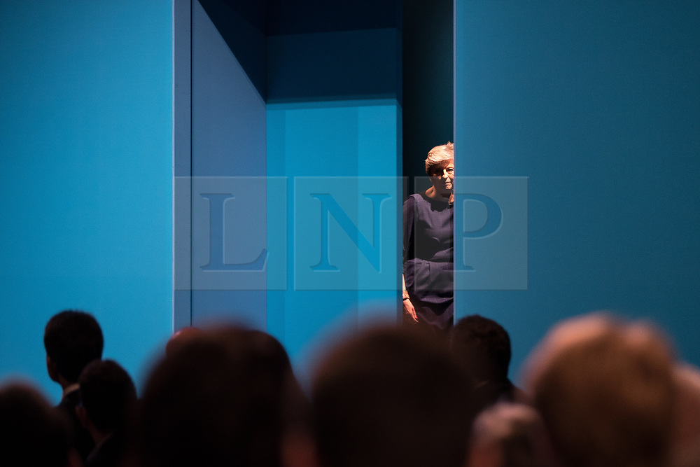 © Licensed to London News Pictures . 04/10/2017. Manchester, UK. Prime Minister THERESA MAY steps to the stage from the wings to deliver her keynote speech on the fourth and final day of the Conservative Party Conference at the Manchester Central Convention Centre . Photo credit: Joel Goodman/LNP