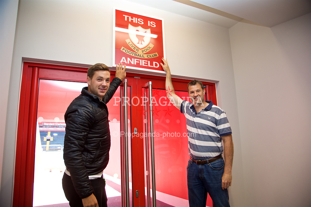 LIVERPOOL, ENGLAND - Sunday, June 18, 2017: Marcus Willis and Barry Cowan touch the This Is Anfield sign on a visit Anfield during Day Four of the Liverpool Hope University International Tennis Tournament 2017. (Pic by David Rawcliffe/Propaganda)