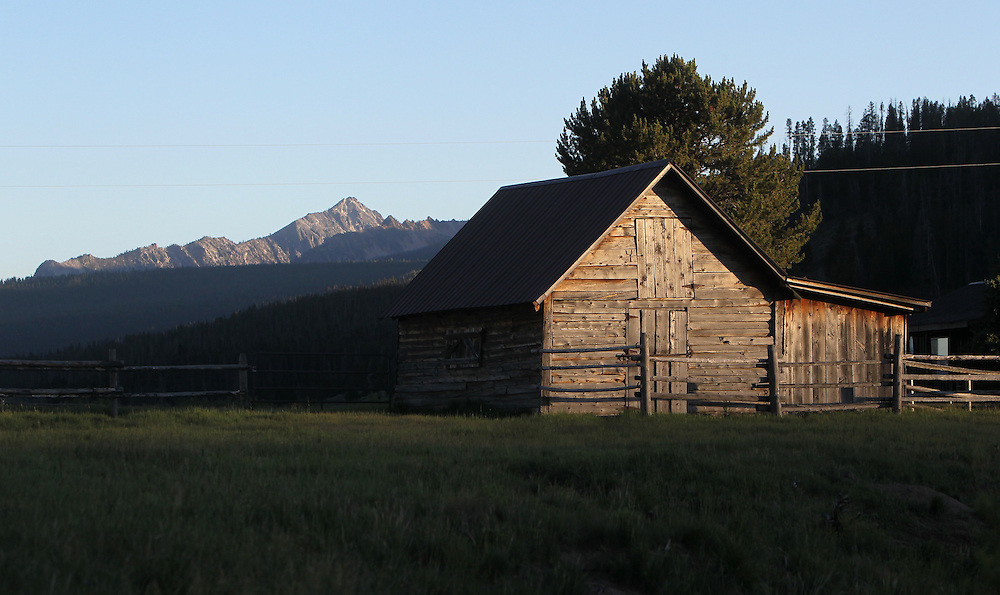 The sun sets on a barn in the Sawtooth Mountains in central Idaho south of the town of Stanley on Saturday July 13, 2013.