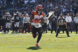 OAKLAND, CA - NOVEMBER 17: Running back Joe Mixon #28 of the Cincinnati Bengals rushes up field for a touchdown against the Oakland Raiders during the first quarter at RingCentral Coliseum on November 17, 2019 in Oakland, California. The Oakland Raiders defeated the Cincinnati Bengals 17-10. (Photo by Jason O. Watson/Getty Images) *** Local Caption *** Joe Mixon