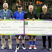 March 1, 2014, Indian Wells, California: <br /> Checks are presented to theYMCA of the Desert and the War Casualty Family Assistance Fund during the McEnroe Challenge for Charity presented by Esurance. <br /> (Photo by Billie Weiss/BNP Paribas Open)