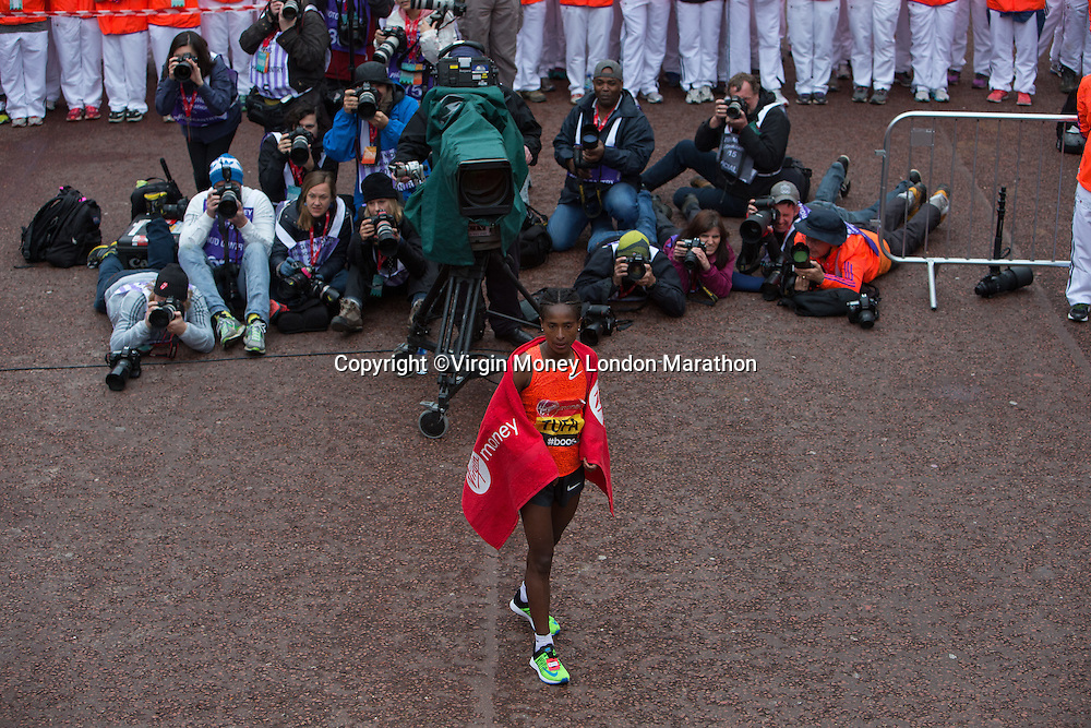 Tigist Tufa of Ethiopia after crossing the finish line to win the Elite Womens race at the Virgin Money London Marathon , Sunday 26th April 2015.<br /> <br /> Dillon Bryden for Virgin Money London Marathon<br /> <br /> For more information please contact Penny Dain at pennyd@london-marathon.co.uk