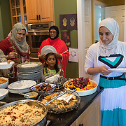 "GREAT FALLS, VA - SEP12: Hanane Elsanousi, celebrates Eid al-Adha, the ""Feast of the Sacrifice"", at an open house September 12, 2016, in Great Falls, Virginia. (Photo by Evelyn Hockstein/For The Washington Post)"