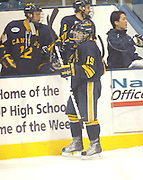 Canisius Griffins Cory Conacher (19) gets congratulated by the Griffins bench after scoring his third goal of the second period against the LSSU Lakers Friday night in Sault Ste. Marie, MI.