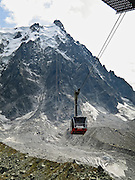 Take the spectacular Aiguille du Midi téléphérique (world's highest vertical ascent cable car) from Chamonix (3300 feet elevation) to Aiguille du Midi (12,600 feet) in the Mont Blanc massif, France, Europe.