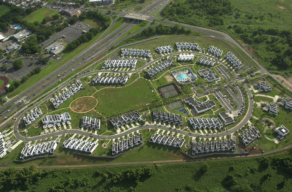 Aerial views of Ft. Buchanan housing area from a USCG HH-65B helicopter, stationed at Coast Guard Air Station Borinquen in Puerto Rico.  (U.S. Air Force photo/Master Sgt. Lance Cheung)..