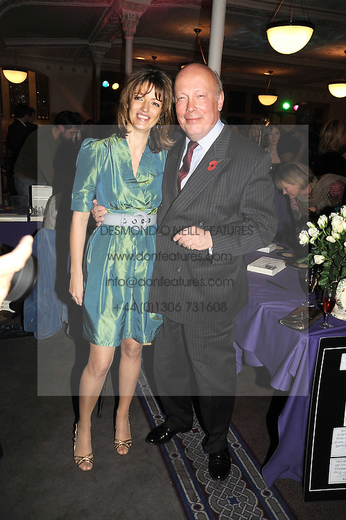 PETRONELLA WYATT and JULIAN FELLOWES at a party to celebrate the publication of 'Past Imperfect' by Julian Fellowes held at Cadogan Hall, 5 Sloane Terrace, London SW1 on 4th November 2008.