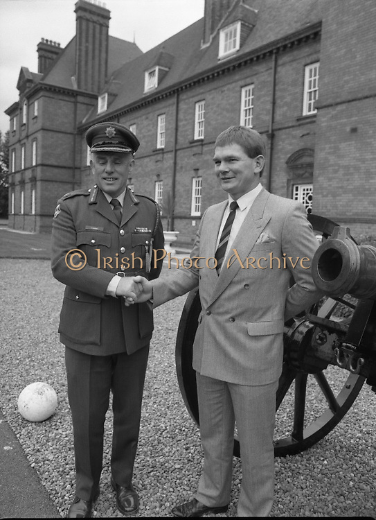 Ciaran Fitzgerald Honoured..1986..05.09.1986..09.05.1986..5th September 1986..To mark his retirement from the Defence Forces, Ciaran Fitzgerald was presented with a Hi-fi system by his colleagues. Ciaran is a noted rugby player and has captained Ireland in many international matches...Pictured on his retirement from the Defense Forces Ciaran Fitzgerald poses with GOC.Eastern Command, Brig,General Vincent Savino.