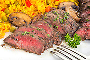 Flank steak grilled with yellow rice and mushrooms