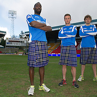 St Johnstone players Gregory Tade, Chris Millar and Murray Davidson pictured at McDiarmid Park this morning ahead of tomorrow's game against Inverness where they donned 'saints tartan' kilts to support the Perth 2013 Kilt Run which wil take place on Saturday 10th August 2013, the aim is to attact over 2000 kilt runners to break the world record.<br /> Picture by Graeme Hart.<br /> Copyright Perthshire Picture Agency<br /> Tel: 01738 623350  Mobile: 07990 594431