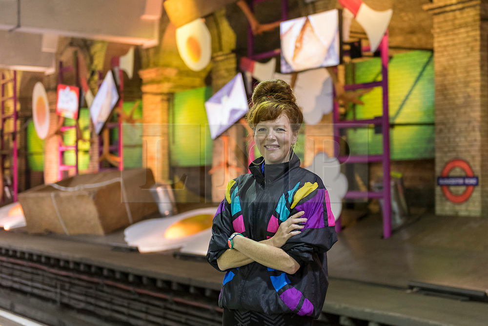 """© Licensed to London News Pictures. 07/06/2018. LONDON, UK.  British artist Heather Phillipson poses against her new work """"my name is lettie eggyscrub"""", a major commission for Art on the Underground.  The installation fills the 80m platform at Gloucester Road Underground station.  Photo credit: Stephen Chung/LNP"""
