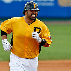 March 22, 2012; Bradenton, FL, USA; Pittsburgh Pirates catcher Rod Barajas (26) rounds the bases after hitting a homerun during the bottom of the fourth inning of a spring training game against the Tampa Bay Rays at McKechnie Field. Mandatory Credit: Derick E. Hingle-US PRESSWIRE