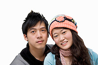 Portrait of young couple over white background