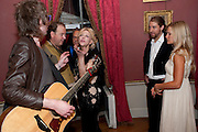 MICKEY; MARK CORNELL;; COURTNEY LOVE;,MIKE LINDER; LADY ALEXANDRA GORDON-LENNOX;  The Goodwood Ball. In aid of Gt. Ormond St. hospital. Goodwood House. 27 July 2011. <br /> <br />  , -DO NOT ARCHIVE-© Copyright Photograph by Dafydd Jones. 248 Clapham Rd. London SW9 0PZ. Tel 0207 820 0771. www.dafjones.com.