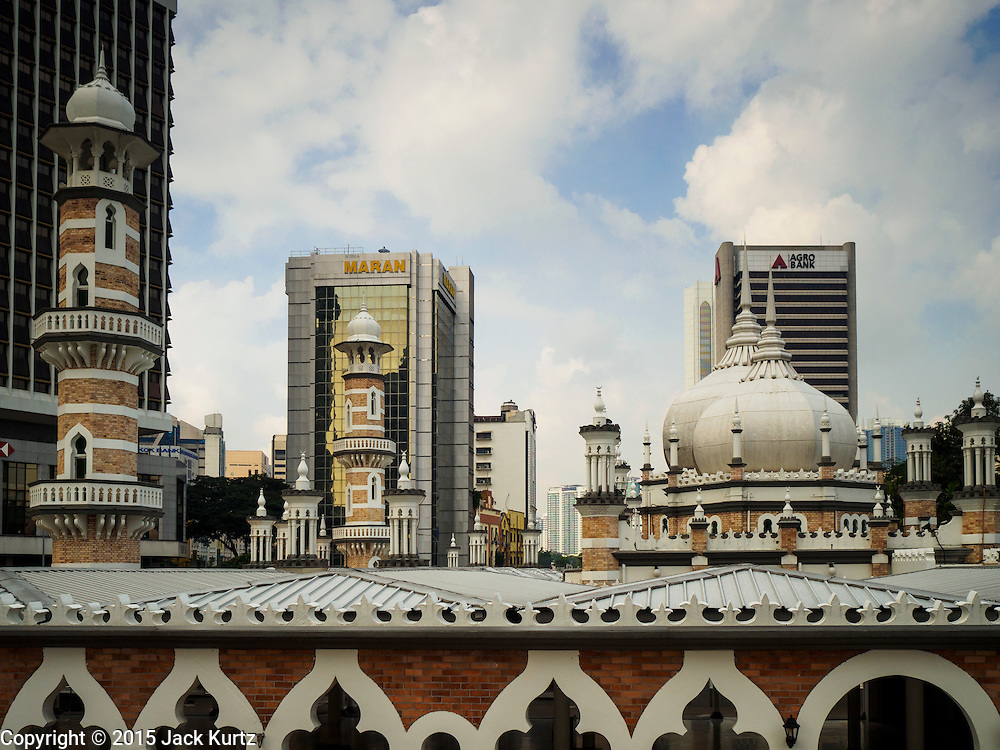 06 JUNE 2015 - KUALA LUMPUR, MALAYSIA: Roofline of the Masjid Jamek. Built in 1909, Jamek Mosque is one of the oldest mosques in Kuala Lumpur. It is located at the confluence of the Klang and Gombak River and was designed by Arthur Benison Hubback. The mosque was a built in the style of Mughal (northern India) architecture. Before the national mosque, Masjid Negara, was opened in 1965, Masjid Jamek served as Kuala Lumpur's main mosque.      PHOTO BY JACK KURTZ