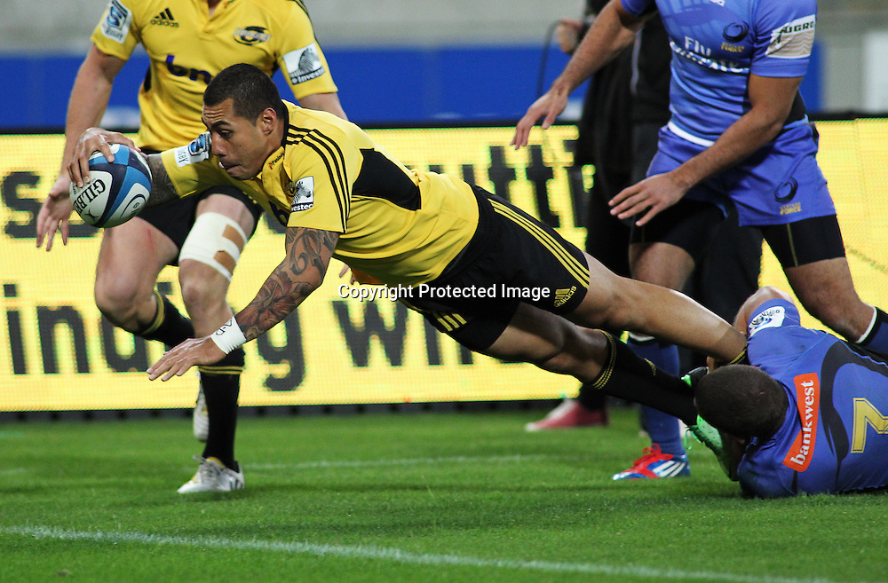 Hurricanes' Tusi Pisi dives in to score a try. Investec Super Rugby, Hurricanes V Force at Westpac Stadium, Wellington, Friday 19 April 2013. Photo.: Grant Down / photosport.co.nz