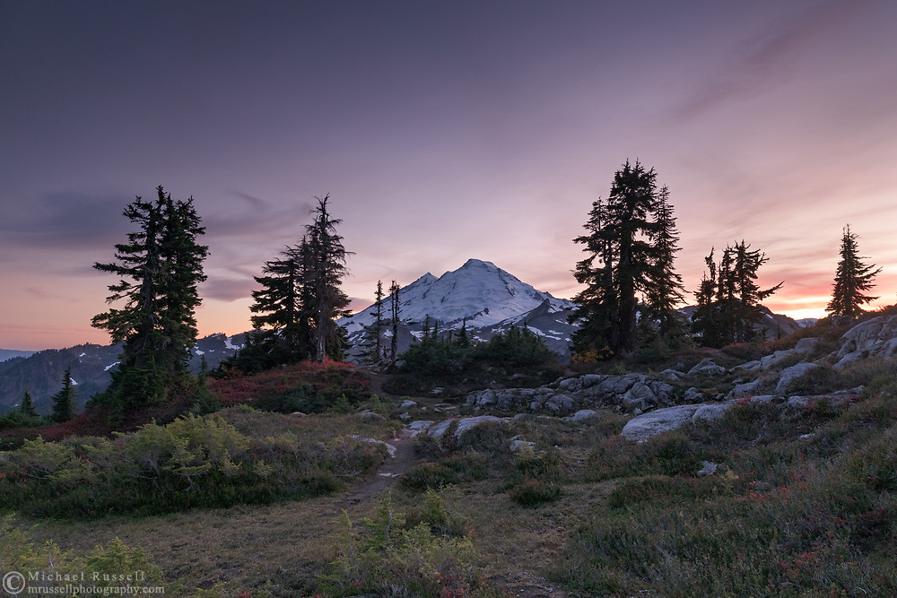 Mount Baker (Komo Kulshan) after the sun has set on the Mount Baker-Snoqualmie National Forest of Washington State. Photographed in the fall, just before the first snow, from Huntoon Point on Kulshan Ridge.