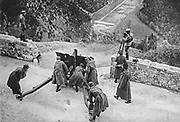 Italian gun about to fire on Austrian position across an Alpine valley.