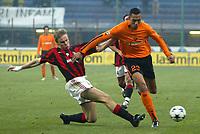 Milano, 14/01/2004Gara di andata dei quarti di finale di Coppa Italia Milan-AS RomaCarew challenged by Laursen<br /> Foto Graffiti