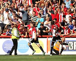 Brentford celebrate their late equaliser - Mandatory by-line: Robbie Stephenson/JMP - 07966386802 - 08/08/2015 - SPORT - FOOTBALL - Brentford,England - Griffin Park - Brentford v Ipswich Town - Sky-Bet Championship