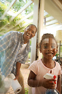 Father and daughter cleaning the windows for Home Depot national advertising print campaign at a home in Atlanta.