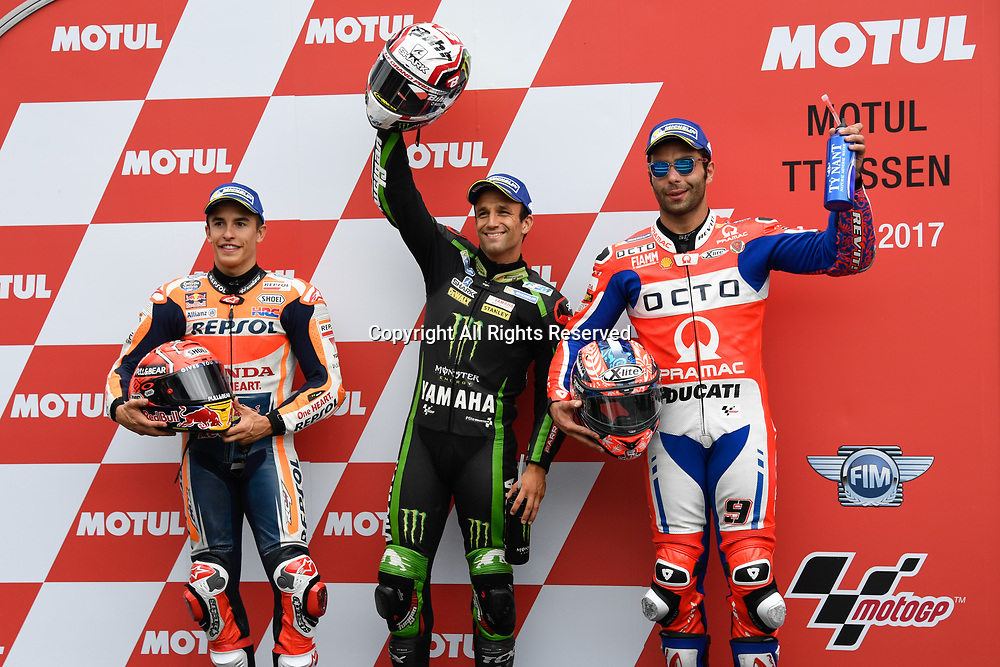 June 24th 2017, TT Circuit, Assen, Netherlands; MotoGP Grand Prix TT Assen, Qualifying Day; from left, Marc Marquez (2nd), Pole winner Johann Zarco and  3rd on grid Danilo Petrucci at parc ferme