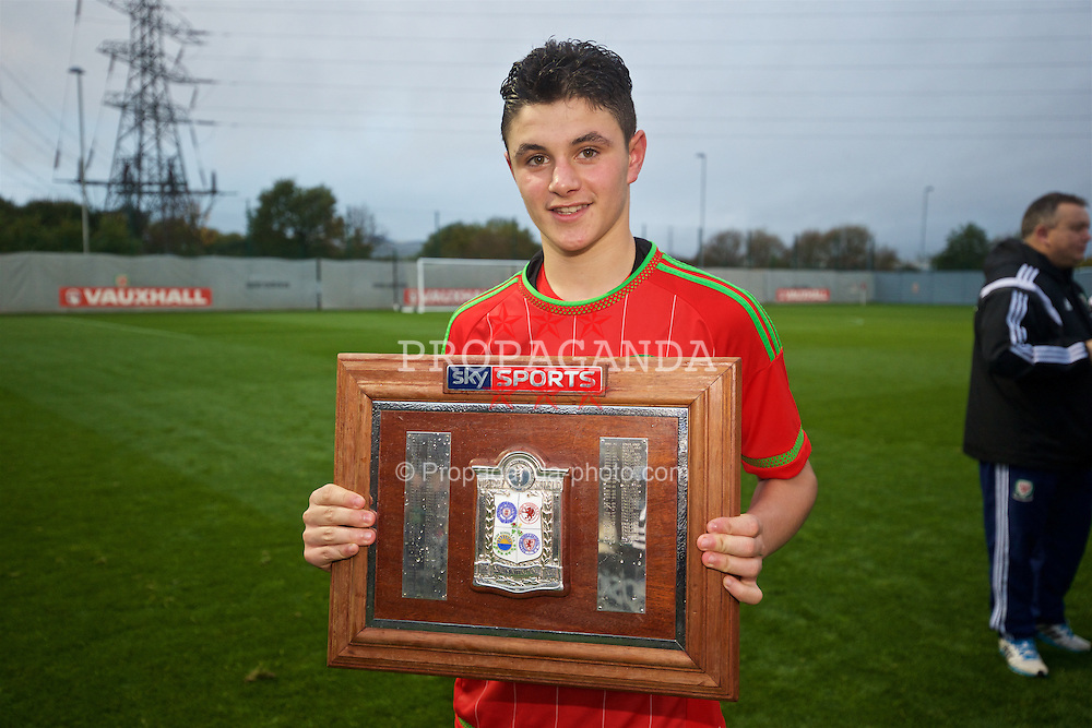 NEWPORT, WALES - Thursday, November 5, 2015: Wales' Steffan Buckeley celebrates with the Victory Shield after a 3-1 victory over Northern Ireland during the Under-16's Victory Shield International match at Dragon Park. (Pic by David Rawcliffe/Propaganda)