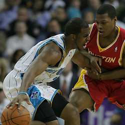 Jan 02, 2010; New Orleans, LA, USA; New Orleans Hornets guard Chris Paul (3) drives in against Houston Rockets guard Kyle Lowry (7) during the first half at the New Orleans Arena. Mandatory Credit: Derick E. Hingle-US PRESSWIRE