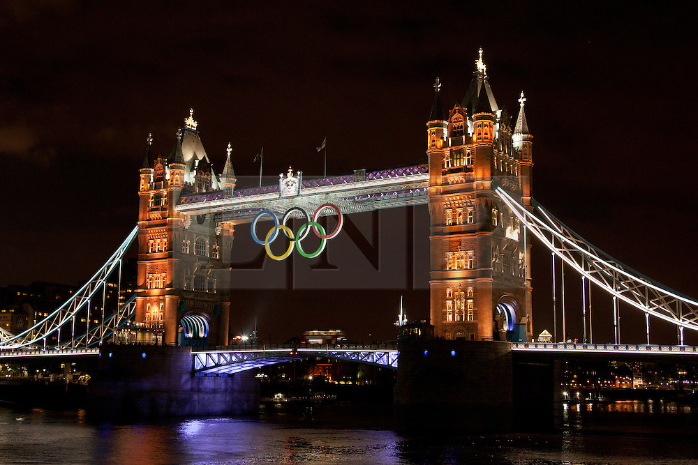© Licensed to London News Pictures. 01/08/2012. Tower Bridge is lit in gold at night for the first time to celebrate Team GB winning two gold medals in the London 2012 Olympic Games today, 1 August 2012. London, UK. Photo credit : Vickie Flores/LNP