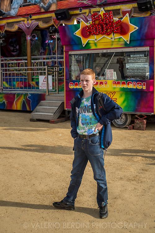 A red-headed boy at a fun fair in Derry.