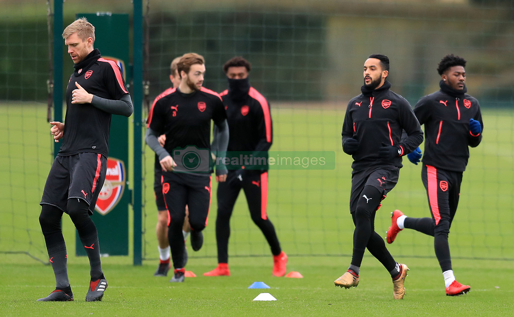 Arsenal's Per Mertesacker (left) and Theo Walcott (second right) during a training session at London Colney.